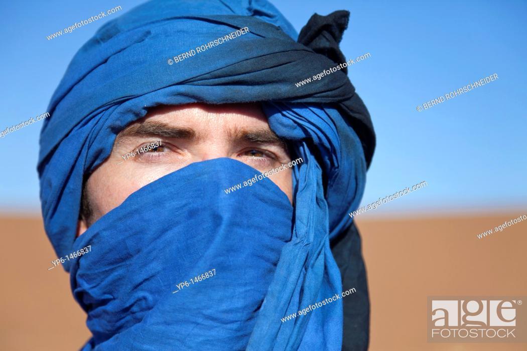 Stock Photo: portrait of a man with turban, Erg Chegaga, Sahara, Morocco.