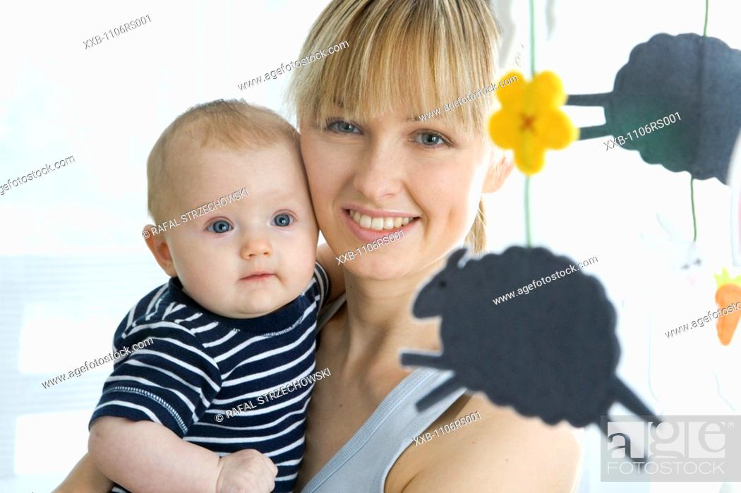 Stock Photo: portrait of a mum with baby.