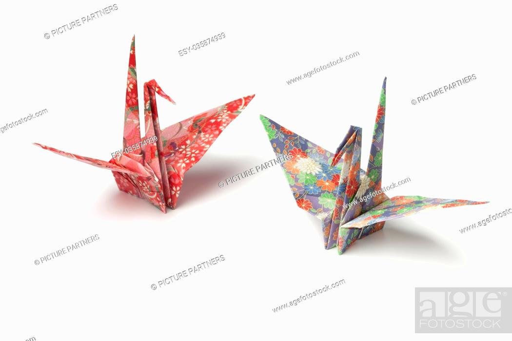 Stock Photo: Two origami paper crane birds on white background.