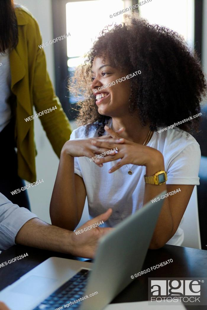 Stock Photo: Smiling businesswoman during a meeting in office.