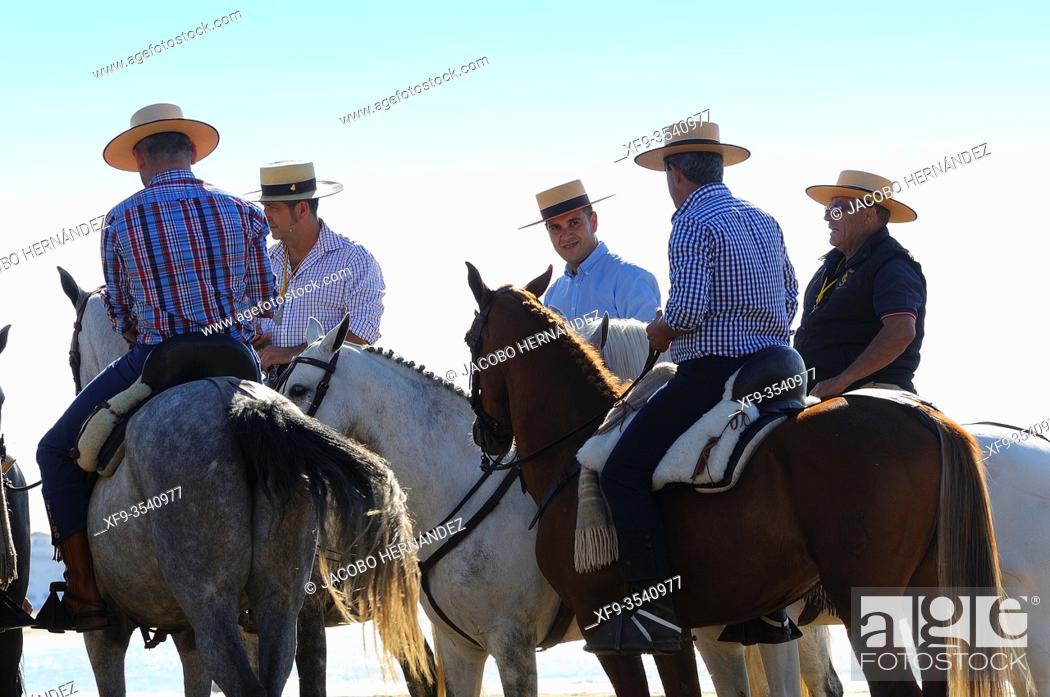 Stock Photo: Pilgrim riders. Pilgrimage of El Rocío embarking to cross the Guadalquivir river. Sanlúcar de Barrameda. Cádiz province. Andalusia. Spain.