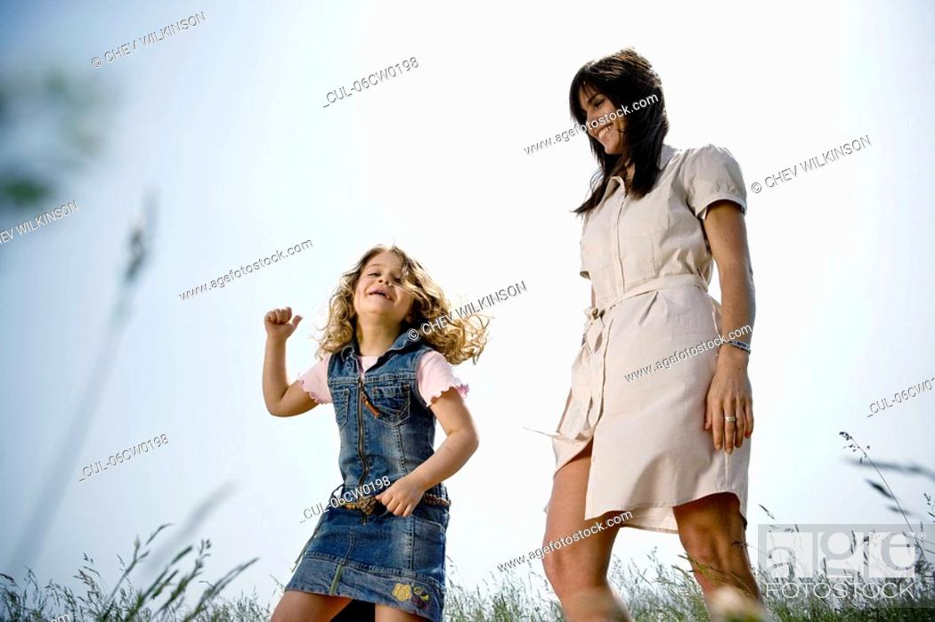 Stock Photo: Mother and daughter dancing.