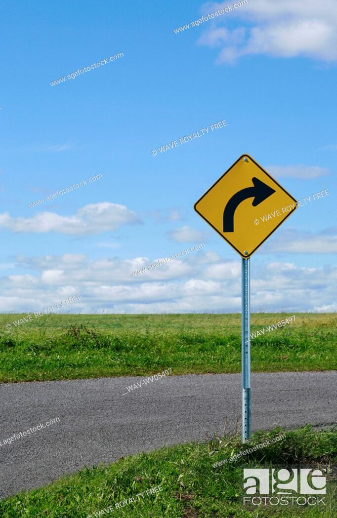 Stock Photo: Curve ahead sign on country road.
