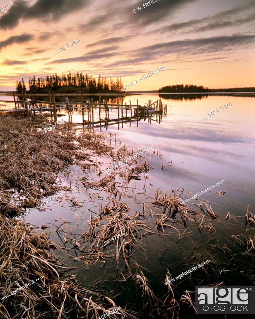 Stock Photo: Clouds After Sunset, Grasses and Water Pump Dock, Astotin Lake, Elk Island National Park, Alberta, Canada.