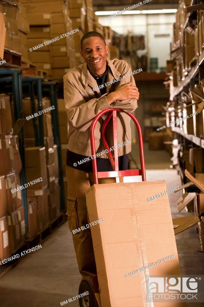 Stock Photo: Black man working in warehouse.