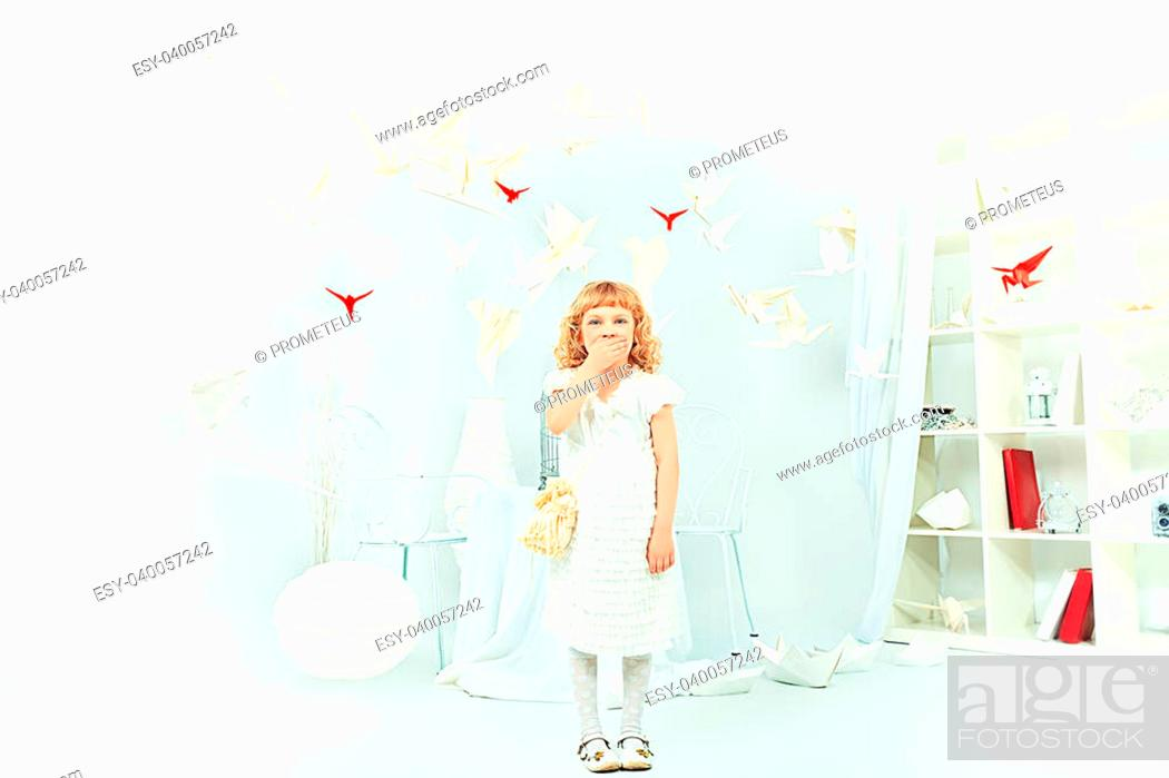 Stock Photo: Beautiful little girl in her dream world surrounded with paper birds.