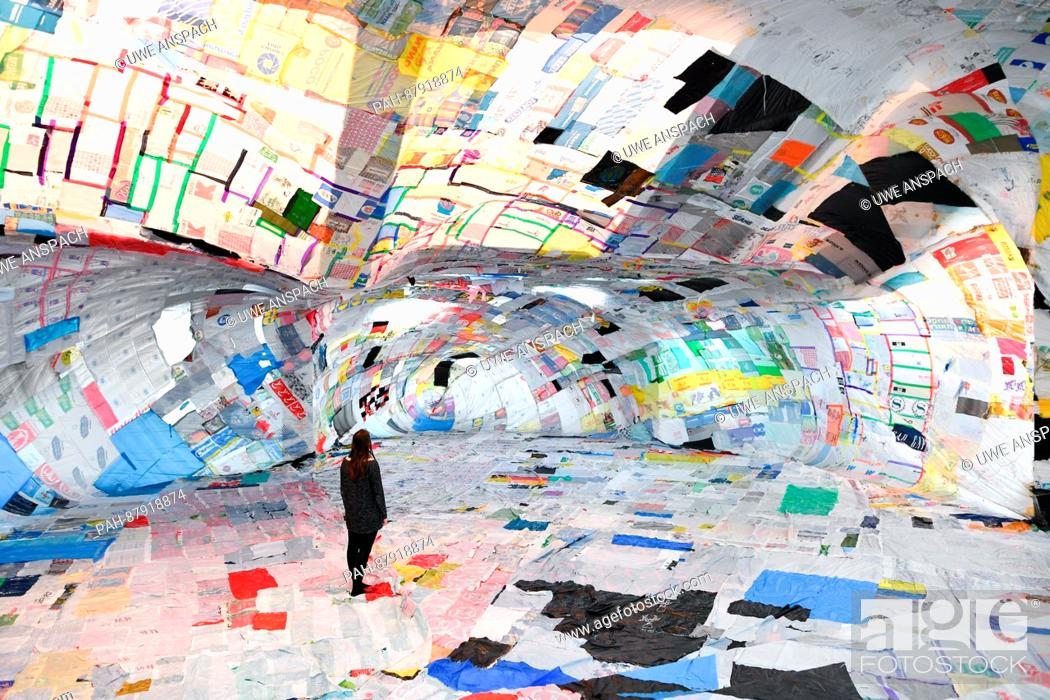 Argentine artist Tomas Saraceno stands in the sculpture made