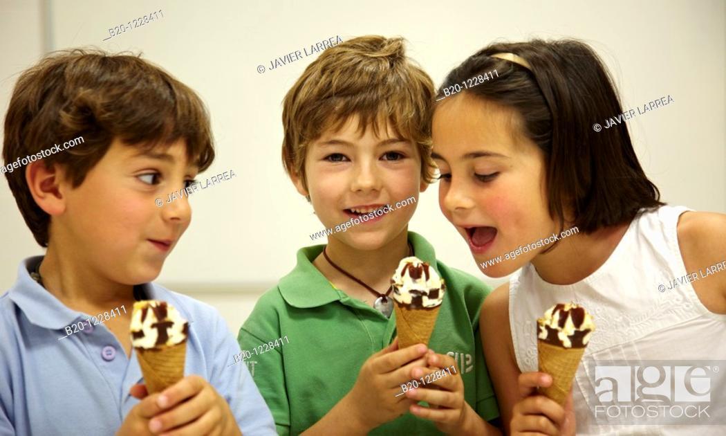 Stock Photo: Children eating ice-cream cones, tasting session in sensory lab, AZTI-Tecnalia Marine and Food Research Center, Derio, Bizkaia, Euskadi, Spain.
