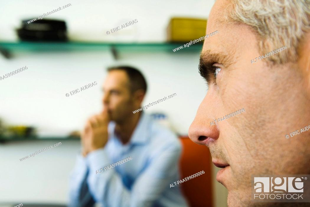 Stock Photo: Man, close-up profile, another man in background.
