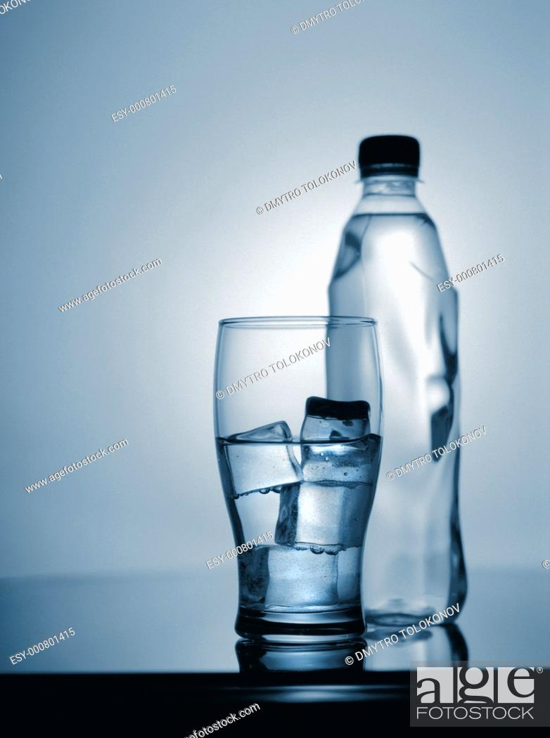Stock Photo: glass of cold mineral water with ice and plastic bottle  scanned from 6x7 film.