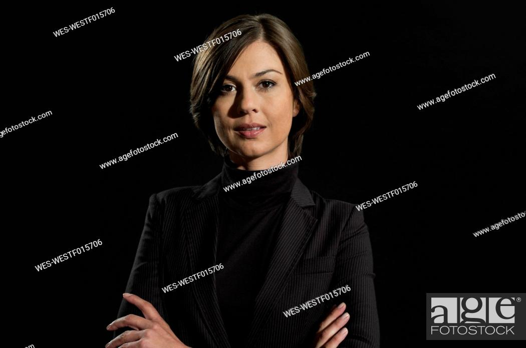 Stock Photo: Mid adult woman with arms crossed, portrait.
