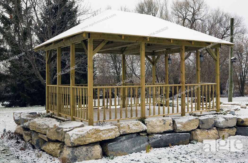 Stock Photo: Wooden Gazebo in a residential backyard in winter, Quebec, Canada.