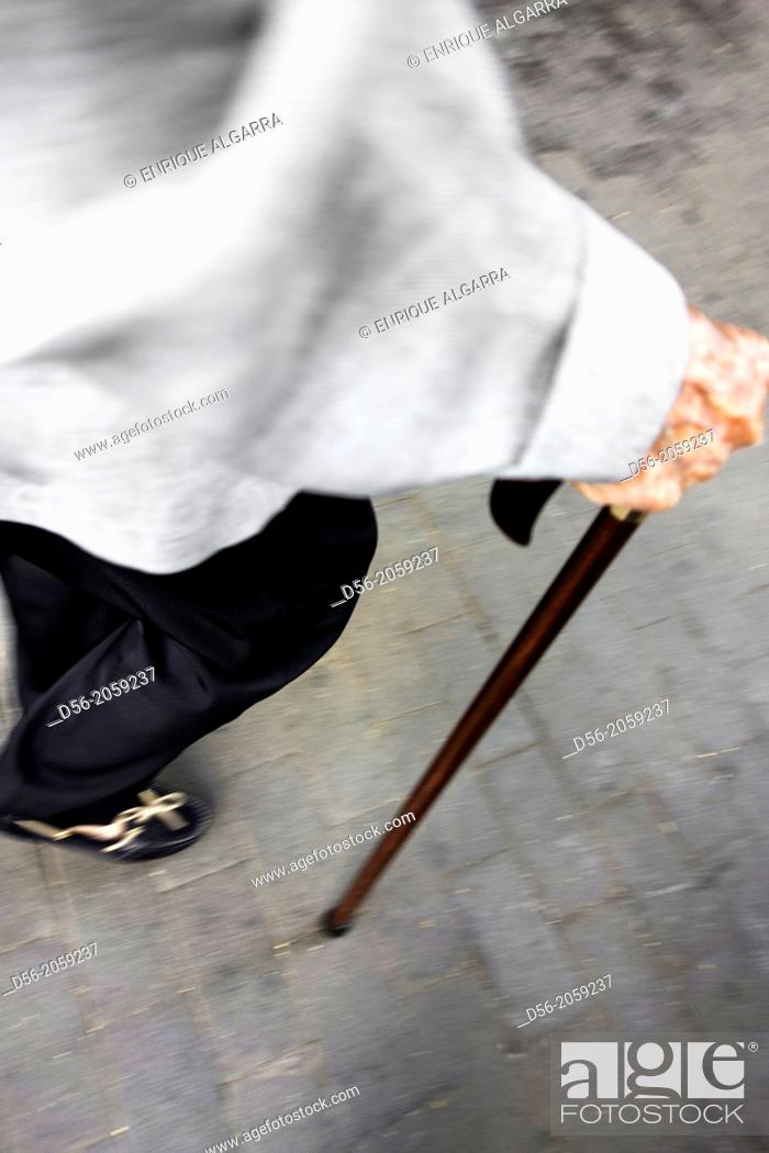 Stock Photo: old woman walking with a cane.
