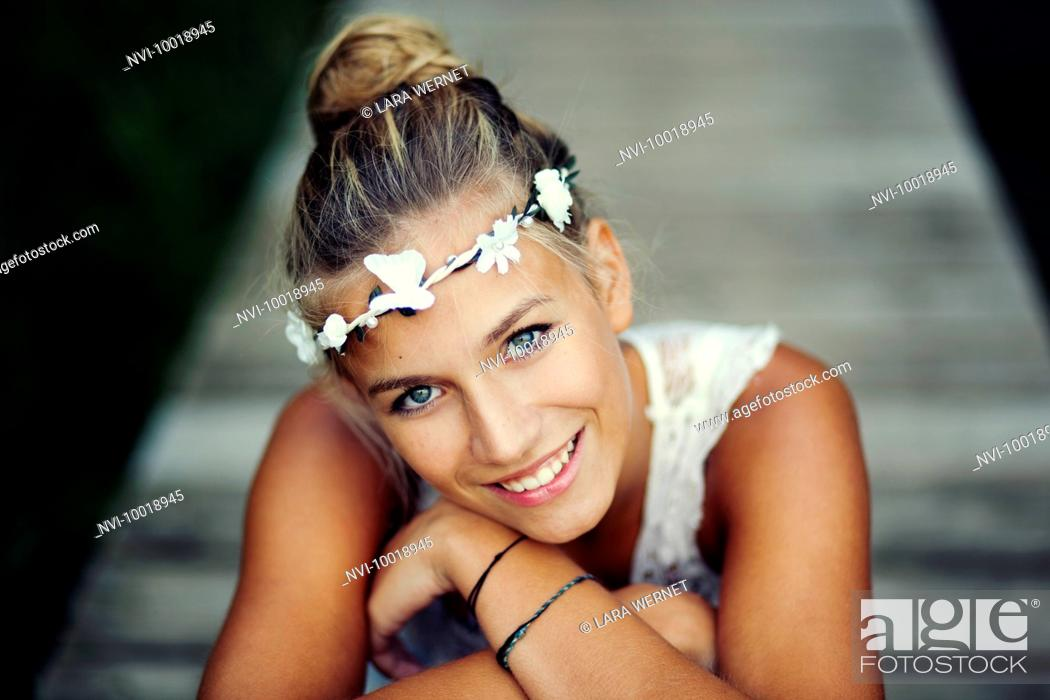 Stock Photo: Young woman in white dress on a footbridge.