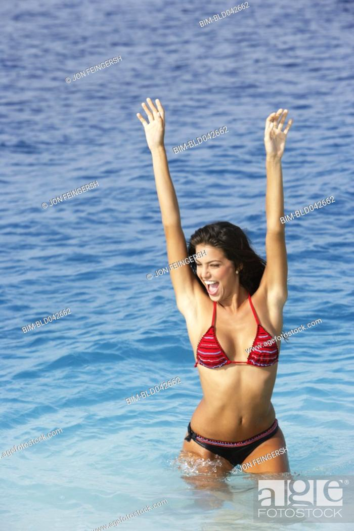 Stock Photo: South American woman in water.