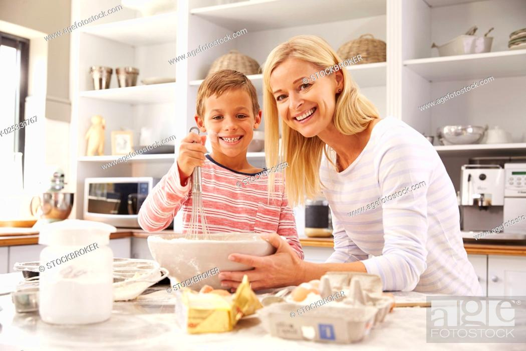 Stock Photo: Mother and son baking together at home.