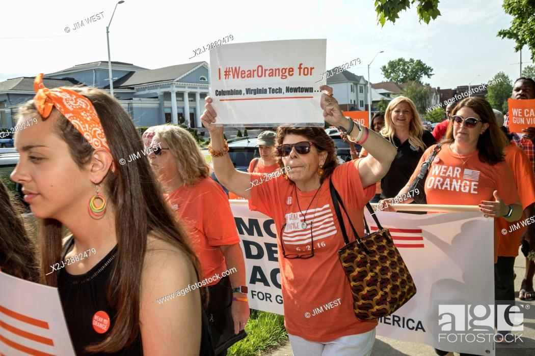 Stock Photo: Detroit, Michigan USA - 3 June 2017 - Members of Moms Demand Action march to end gun violence. Participants chose orange as their color.