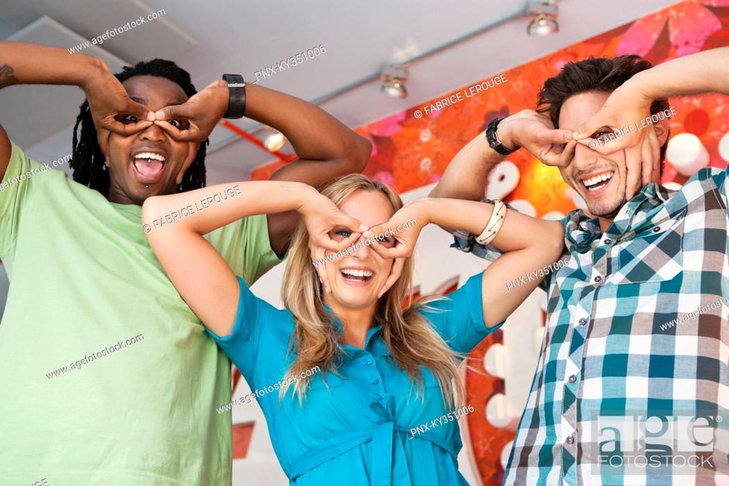 Stock Photo: Friends pretending to wear glasses at a bar.