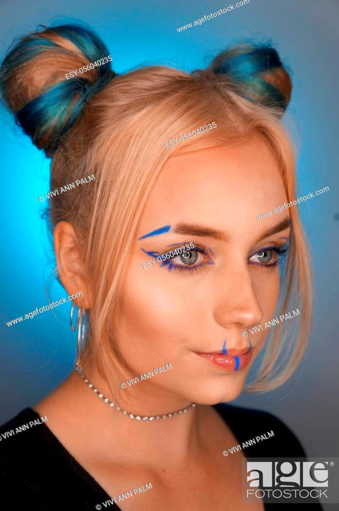 Stock Photo: younb blond woman with makeup.