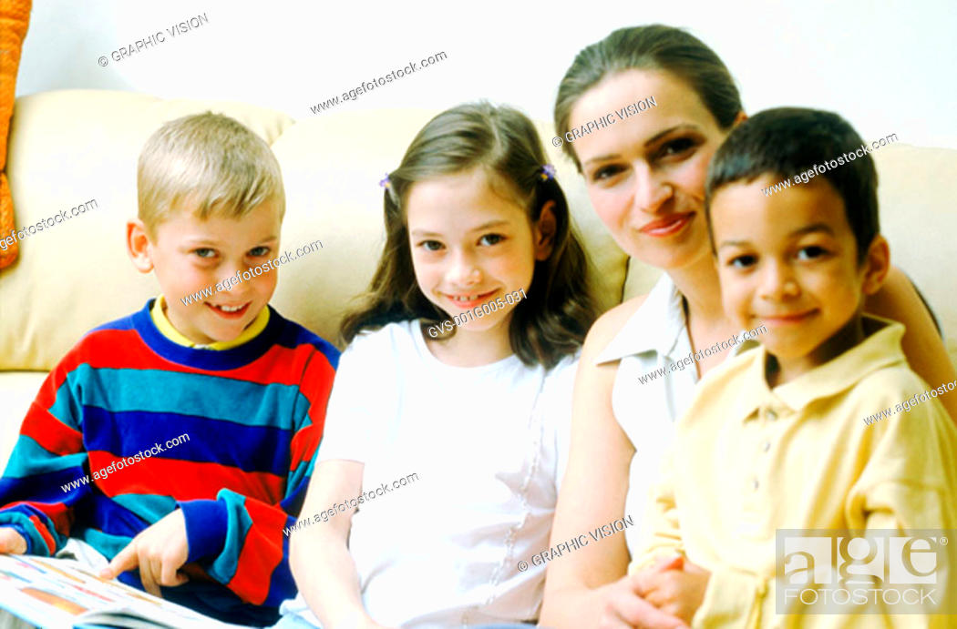 Stock Photo: Portrait of a young woman sitting with children.