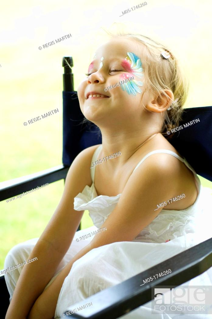 Stock Photo: A 4 year girl having a face painting.