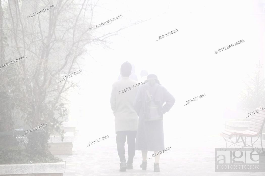 Stock Photo: People walking in the fog. Murano, Venice, Italy.