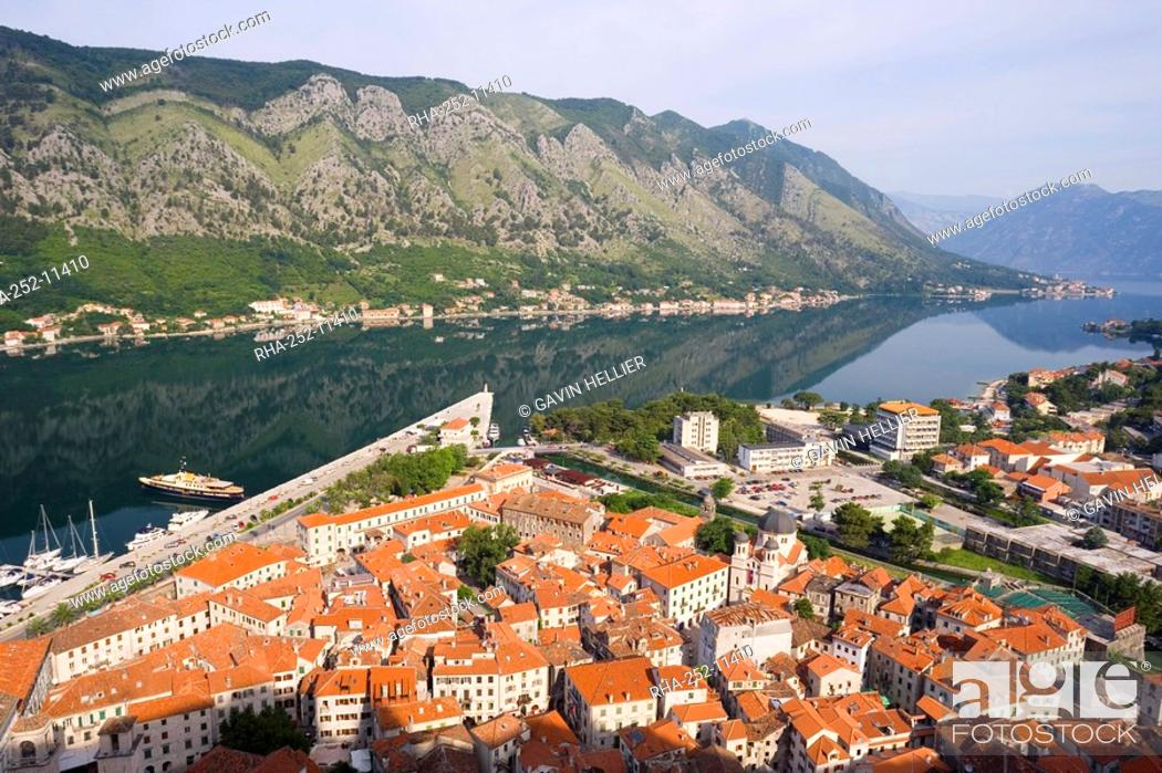 Stock Photo: Elevated view over the Old Town, fjord and mountains from the walls of the Kotor Fortress which forms a continuous belt around the Old Town, Kotor.