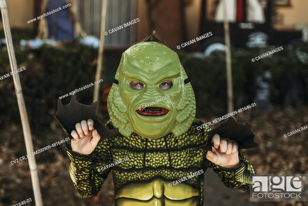 Stock Photo: Portrait of boy dressed as sea monster posing in costume at Halloween.