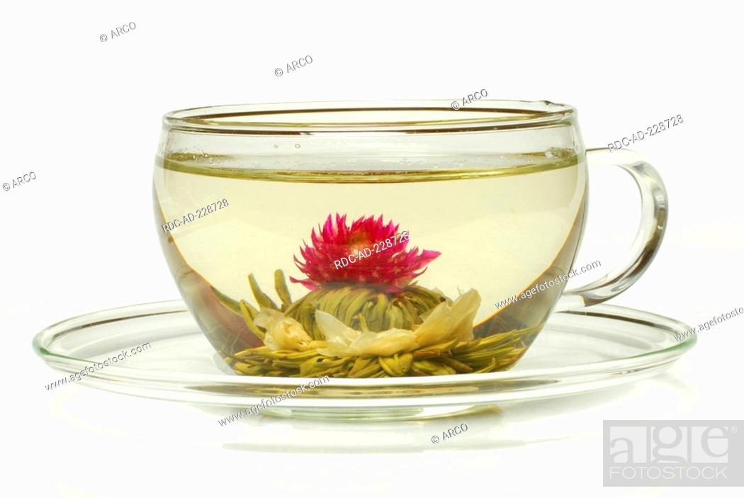 Stock Photo: Cup of flower tea, tea blossom 'Petite Princesse', White Tea with Jasmine and Amaranth blossoms.