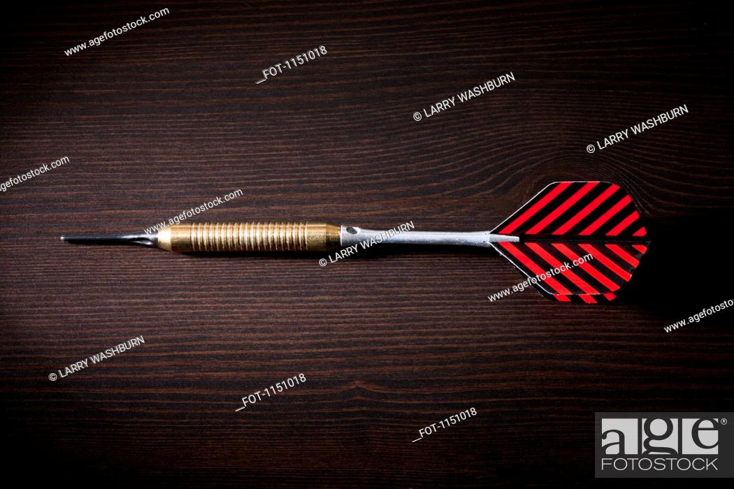 Stock Photo: A single dart lying on its side.