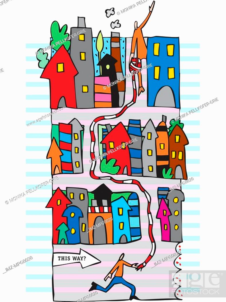 Stock Photo: Two people working together to walk through a maze of houses.