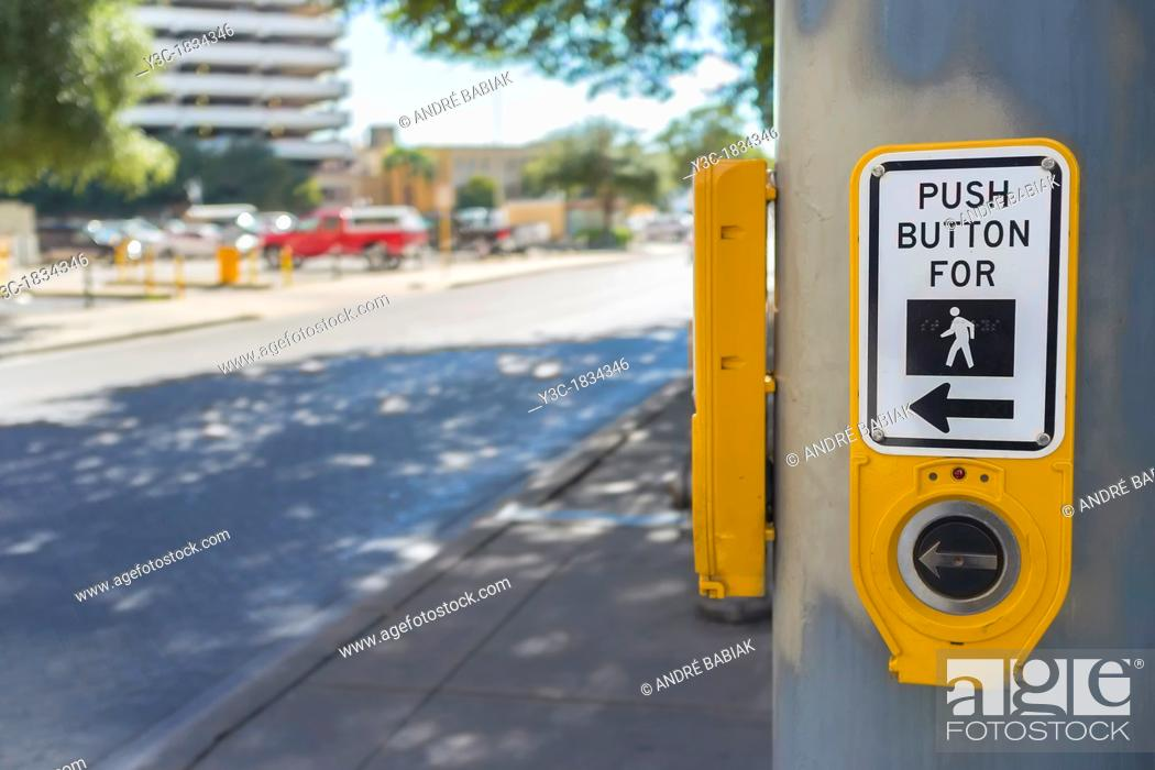 Stock Photo: Push button for pedestrian traffic light.