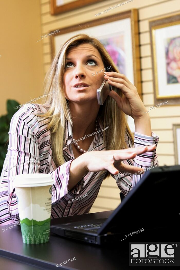 Stock Photo: Woman talking on phone frustrated.