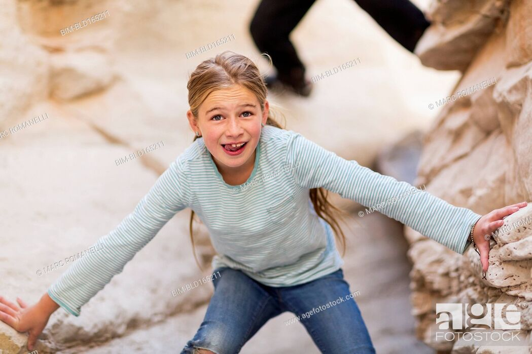 Stock Photo: Caucasian girl exploring desert rock formations.