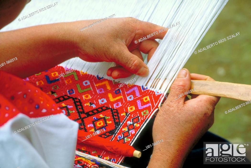 Stock Photo: Tzotzil  Maya woman using a backstrap loom. Chiapas, Mexico.