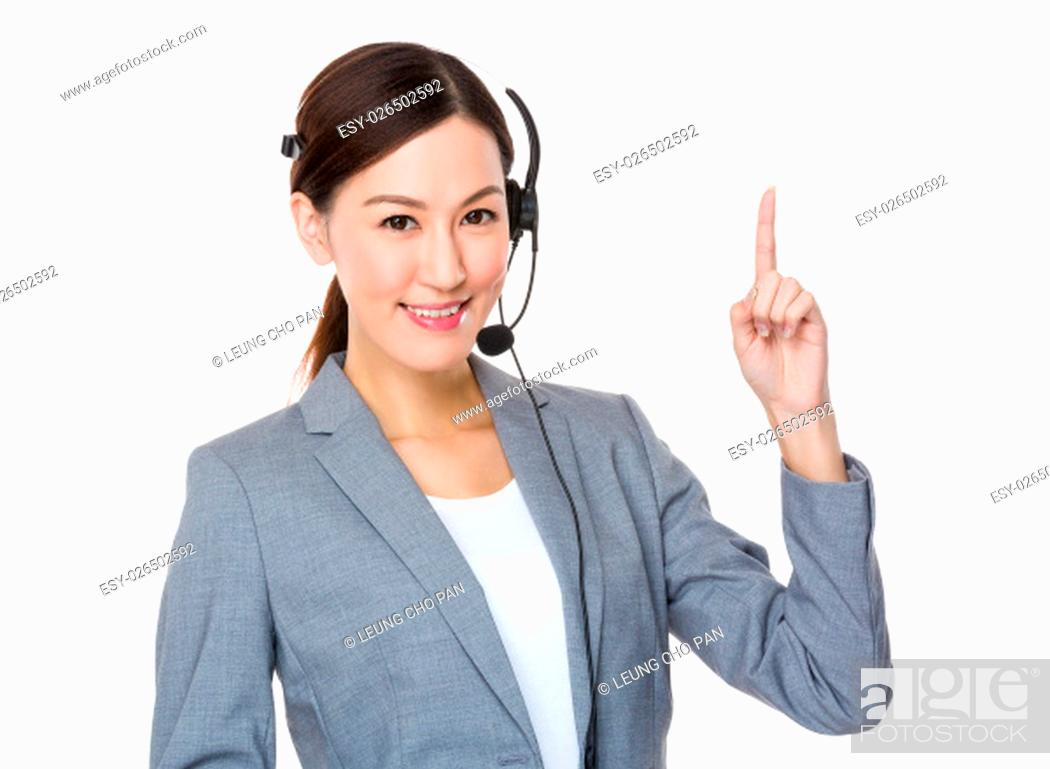 Stock Photo: Customer services officer with finger point up.