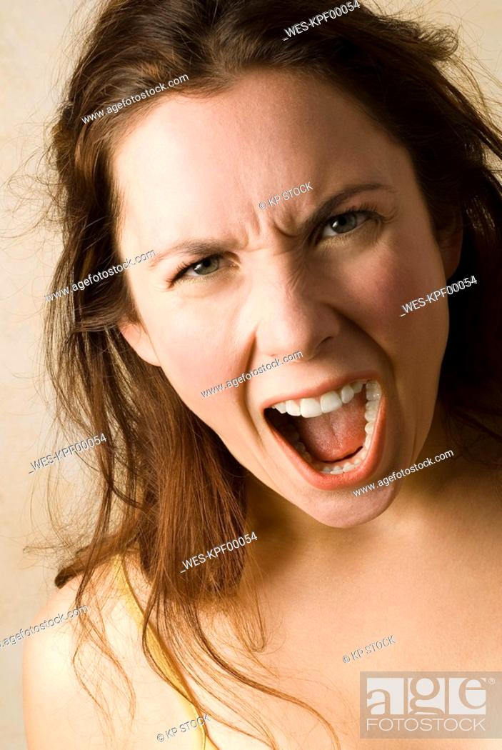 Stock Photo: Young woman, Boiling with rage, close up.