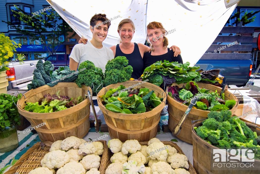 Stock Photo: Women selling produce at farmers' market, Arcata, California.