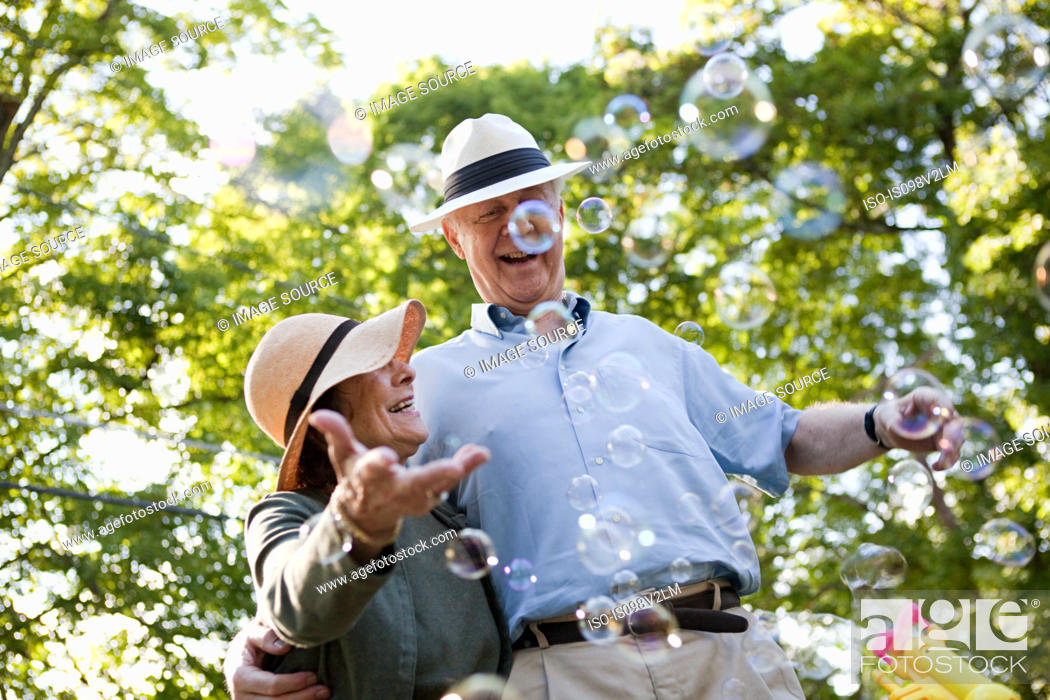 Stock Photo: Senior couple with bubbles.
