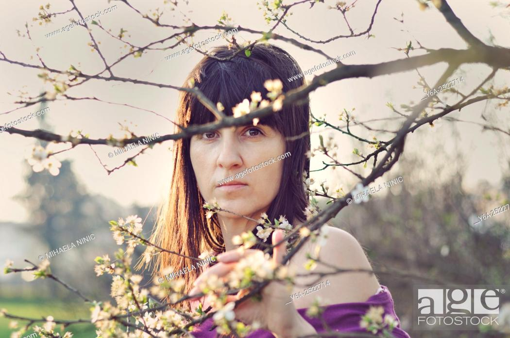Stock Photo: Serious mid adult woman portrait, spring.