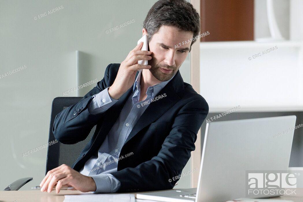 Stock Photo: Businessman making phone call.