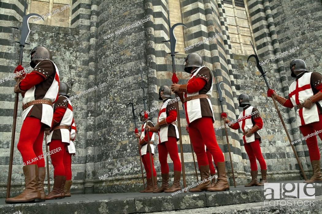 Stock Photo: Low angle view of a group of people wearing medieval costumes and holding spears in a historical procession, Orvieto, Umbria, Italy.