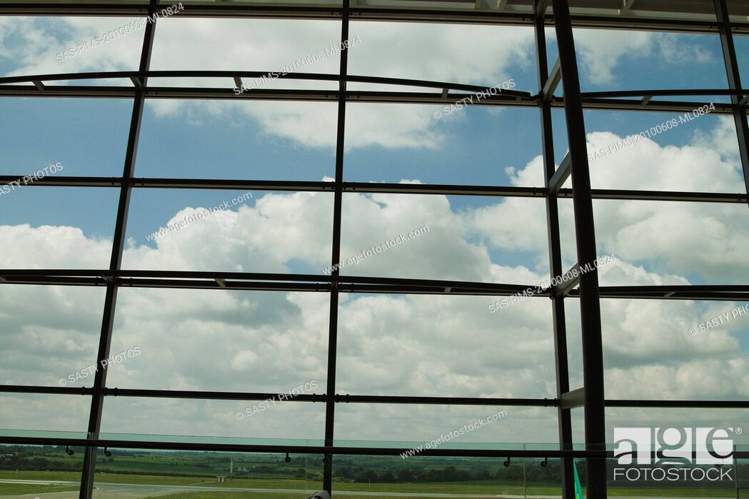 Stock Photo: Clouds viewed through an airport lounge window, Cork Airport, Cork, County Cork, Republic of Ireland.