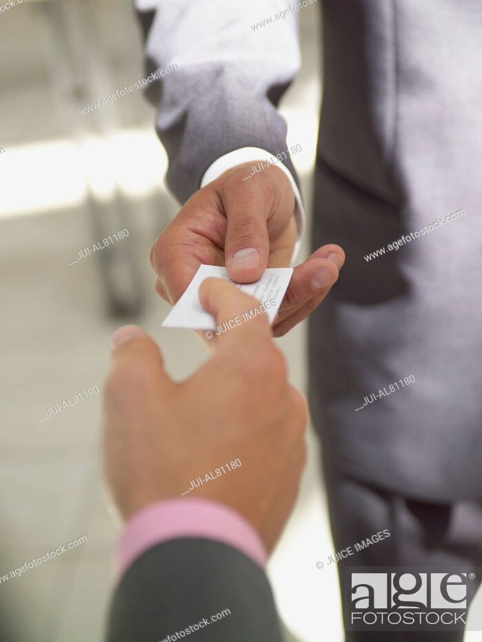 Stock Photo: Businesswoman and businessman exchanging business card.
