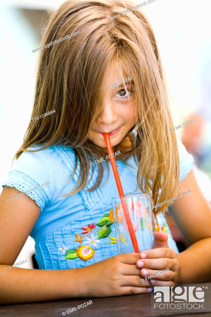 Stock Photo: Drinking from an empty glass young girl.
