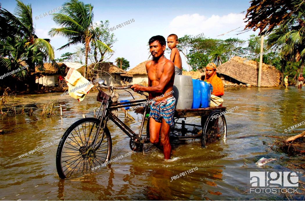 Stock Photo: Containers of driking water carrying by a rickshaw van, aftermath of a devastating cyclone The cyclone Aila swept over the coastal areas of Bangladesh on May 25.