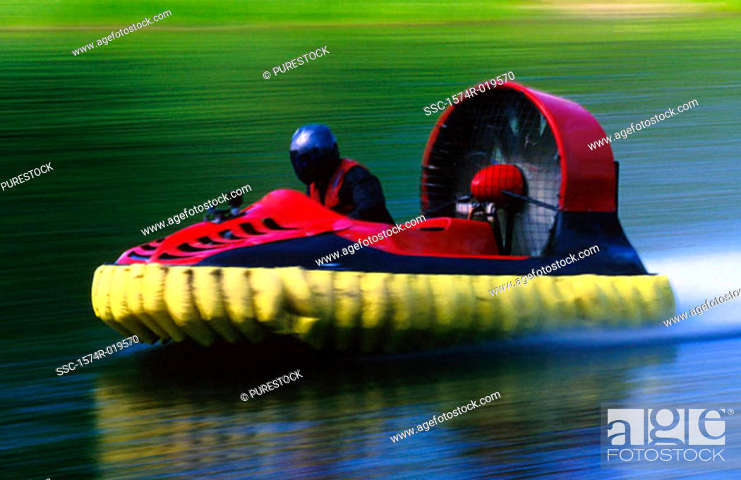 Stock Photo: Side profile of a person riding a hovercraft.