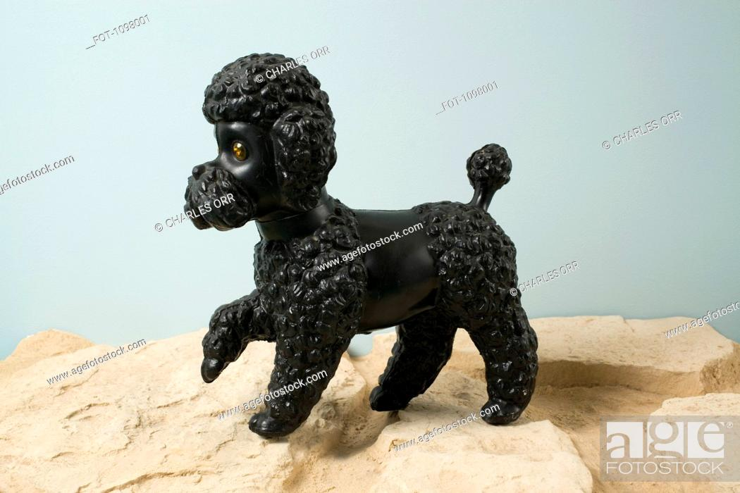 Stock Photo: A kitsch dog figurine with paw raised.