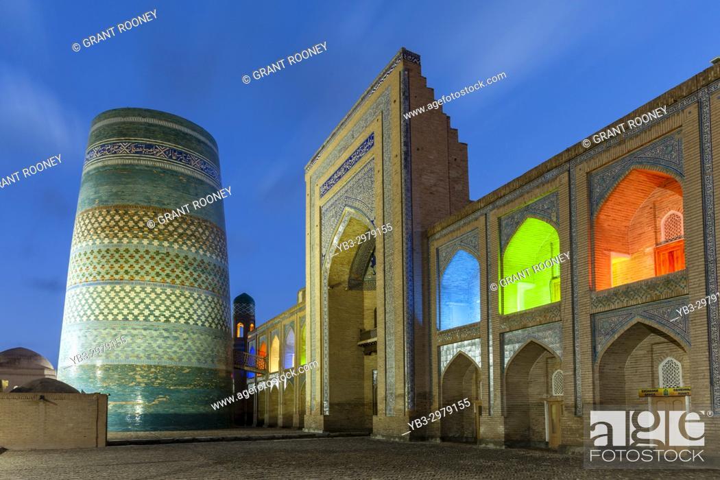 Stock Photo: The Kalta Minar Minaret and Mohammed Amin Khan Madrassa (Orient Star Hotel), Khiva, Uzbekistan.