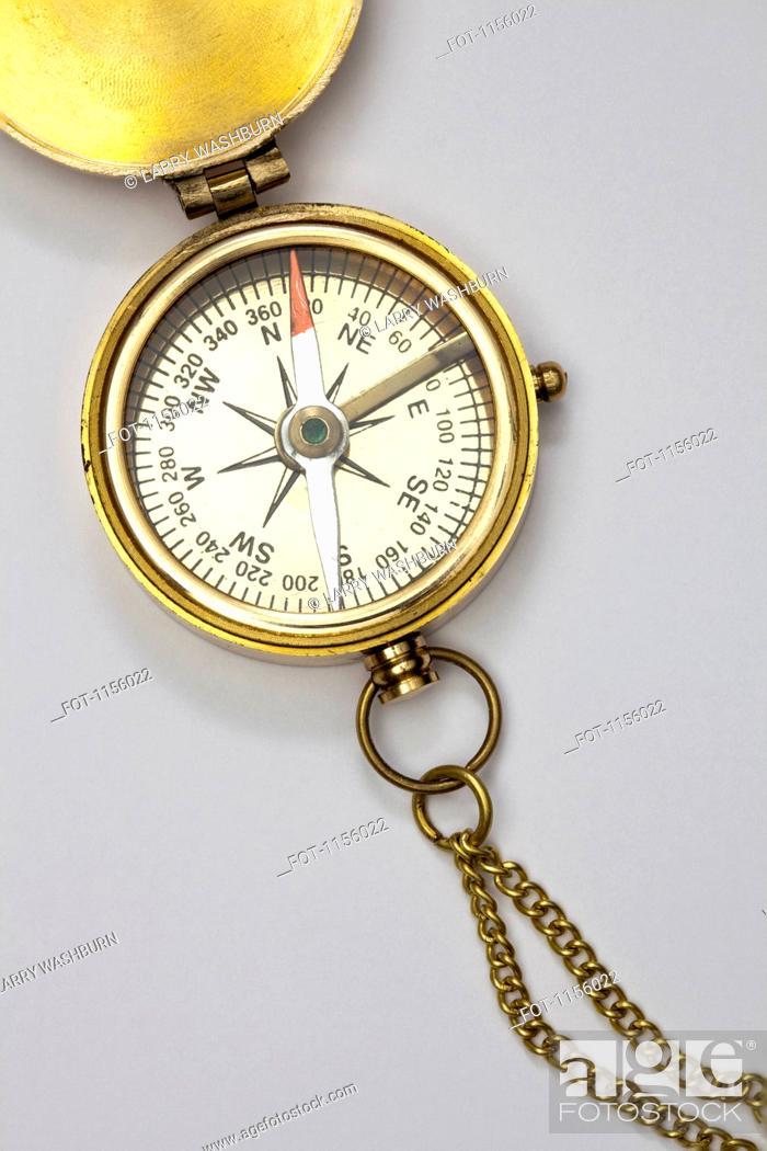 Stock Photo: A brass pocket compass.